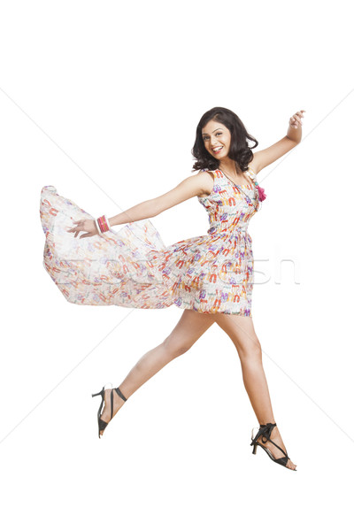 Portrait of a cheerful young woman posing Stock photo © imagedb