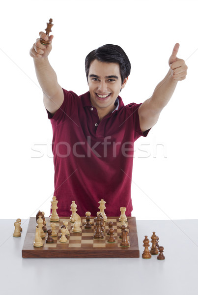 Man celebrating his success after winning chess game Stock photo © imagedb