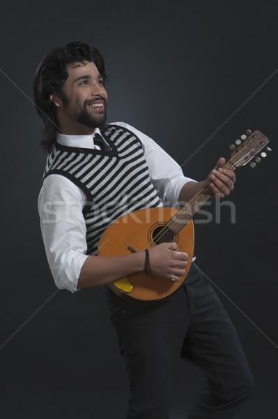 Músico jogar sorridente em pé 20s vertical Foto stock © imagedb