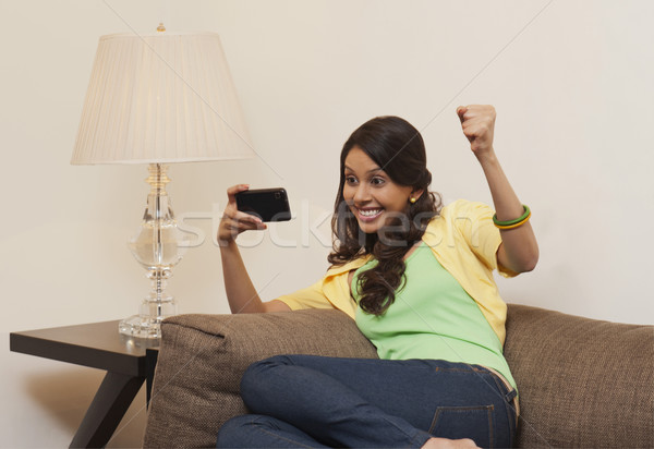 Woman text messaging on a mobile phone Stock photo © imagedb