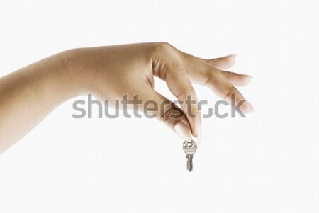 Közelkép kéz tart kulcs nő biztonság Stock fotó © imagedb
