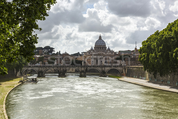 Bridge across a river with a basilica in the background Stock photo © imagedb