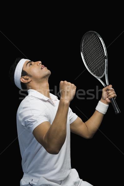 Teniszező ünnepel karok a magasban férfi siker ünneplés Stock fotó © imagedb