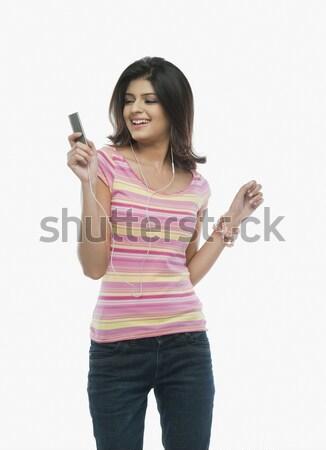 Nő hallgat mp3 lejátszó tánc zene technológia Stock fotó © imagedb