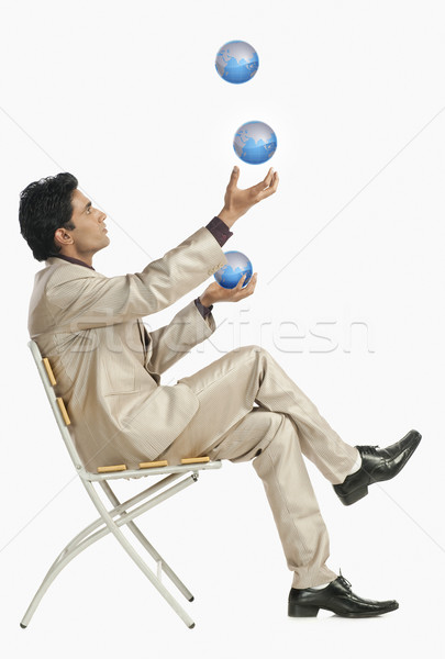 бизнесмен сидят Председатель жонглирование глобусы бизнеса Сток-фото © imagedb