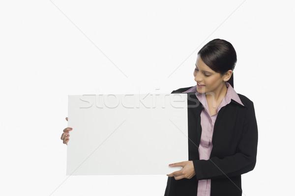 деловая женщина плакат улыбаясь бизнеса исполнительного Сток-фото © imagedb
