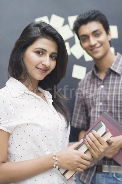 портрет женщины улыбаясь друга книга Сток-фото © imagedb