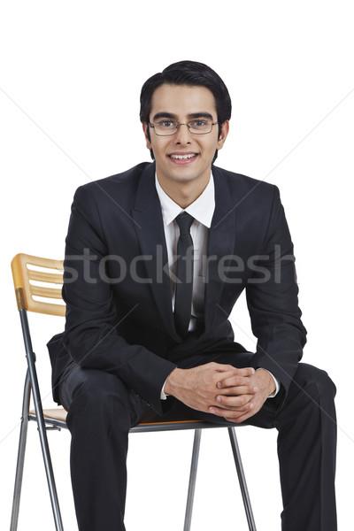 Ritratto imprenditore seduta sedia mani business Foto d'archivio © imagedb