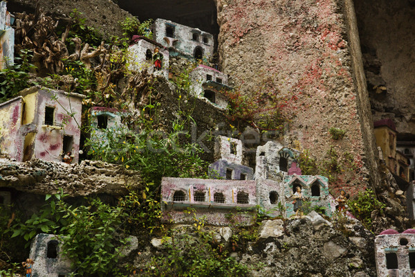 Miniature houses on the rocks Stock photo © imagedb