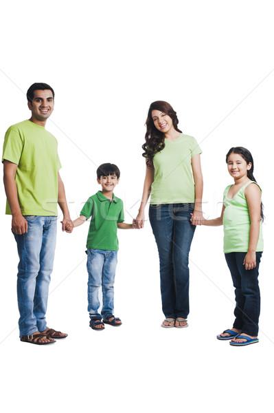 Portre mutlu aile el ele tutuşarak aile baba gülen Stok fotoğraf © imagedb