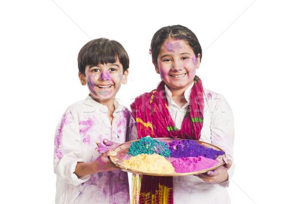 Portrait of brother and sister celebrating Holi festival Stock photo © imagedb