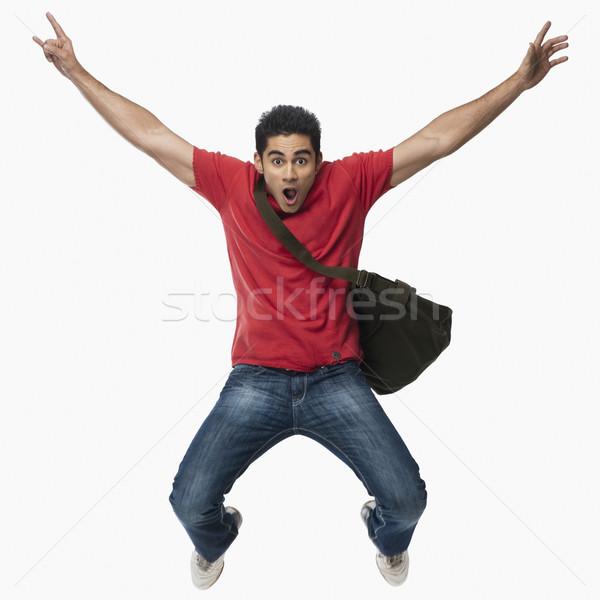Egyetemi hallgató ugrik izgalom férfi oktatás jókedv Stock fotó © imagedb