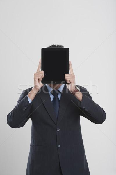 üzletember tart digitális tabletta arc üzlet Stock fotó © imagedb