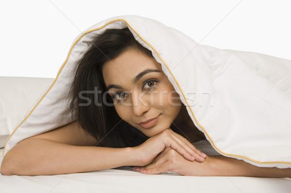 Nő néz paplan portré ágy fiatal Stock fotó © imagedb