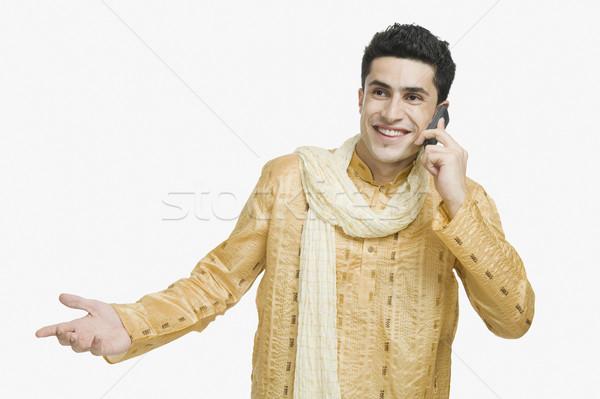 Homme parler téléphone portable souriant sourire technologie Photo stock © imagedb