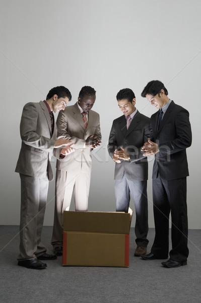 üzletemberek tapsol megvilágított kartondoboz üzlet fény Stock fotó © imagedb