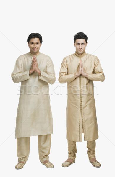 Két férfi ima pozició portré mosolyog hit Stock fotó © imagedb