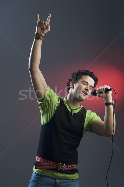 Adam şarkı söyleme eğlence modern renkli görüntü yaşam Stok fotoğraf © imagedb