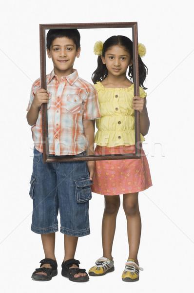 Portre kız erkek boş resim çerçevesi Stok fotoğraf © imagedb