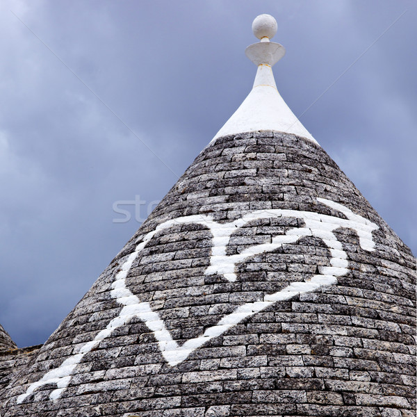 Low angle view of a heart shape painted on a trulli house Stock photo © imagedb