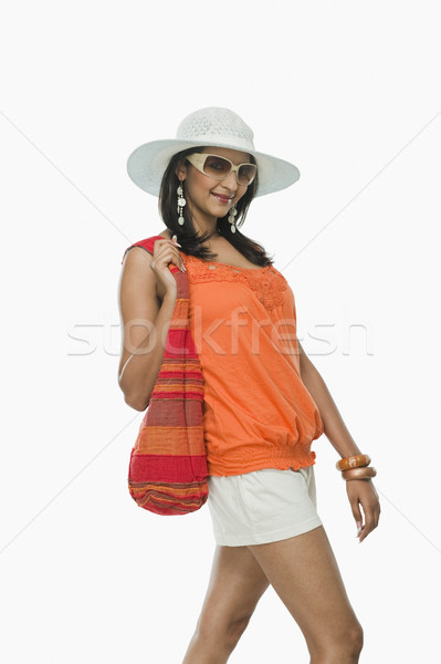 Сток-фото: женщину · сумку · улыбаясь · оранжевый · молодые