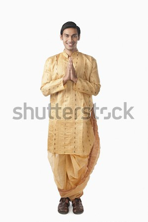 Bengali man standing in a prayer position Stock photo © imagedb