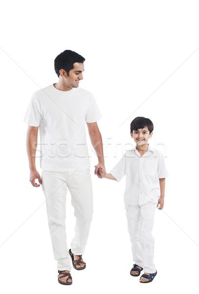 Heureux père en fils mains tenant famille père blanche Photo stock © imagedb