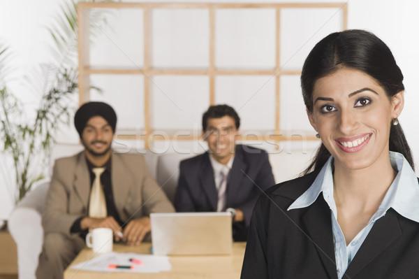 Portrait femme d'affaires collègues bureau réunion table Photo stock © imagedb