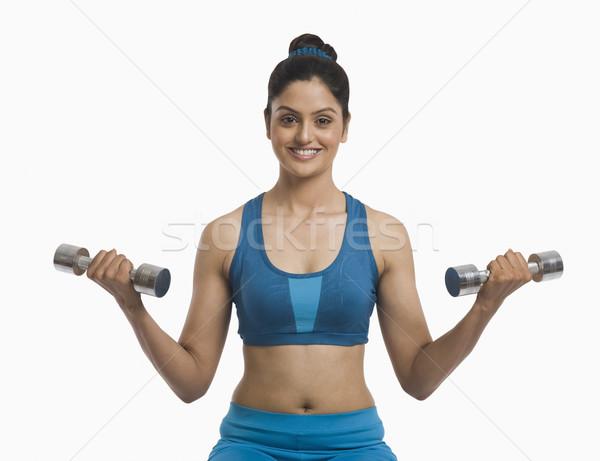 Mujer pesas deporte fitness azul Foto stock © imagedb