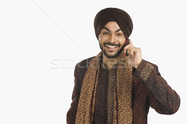 Sikh homem falante telefone móvel retrato felicidade Foto stock © imagedb