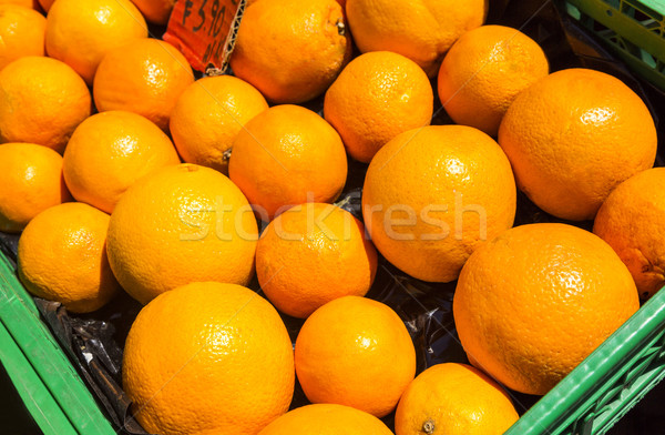 Oranges in a crate for sale at a market stall Stock photo © imagedb