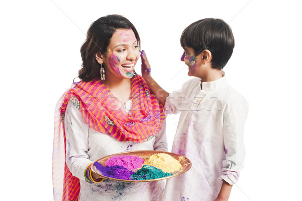 Woman celebrating Holi festival with her son Stock photo © imagedb