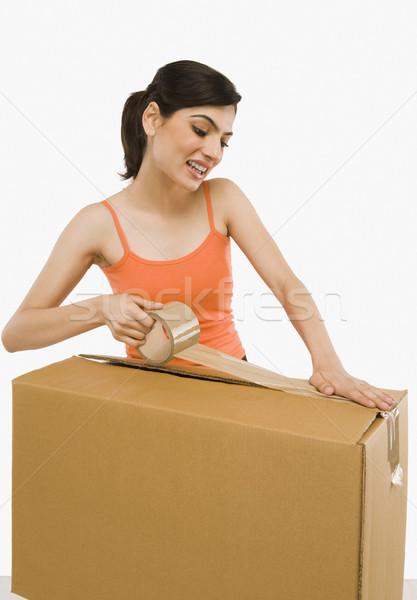 женщину картона лента дома улыбаясь Сток-фото © imagedb