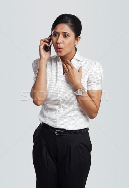 Işkadını konuşma cep telefonu bakıyor iş Stok fotoğraf © imagedb