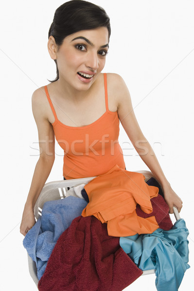 Kadın çamaşır sepeti temizlemek gülen mutluluk Stok fotoğraf © imagedb