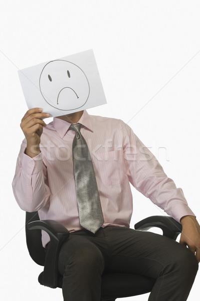 üzletember tart darab papír arc szomorú Stock fotó © imagedb