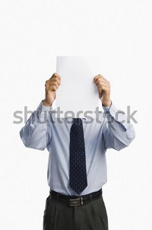 Empresário folha papel em branco homem apresentação Foto stock © imagedb