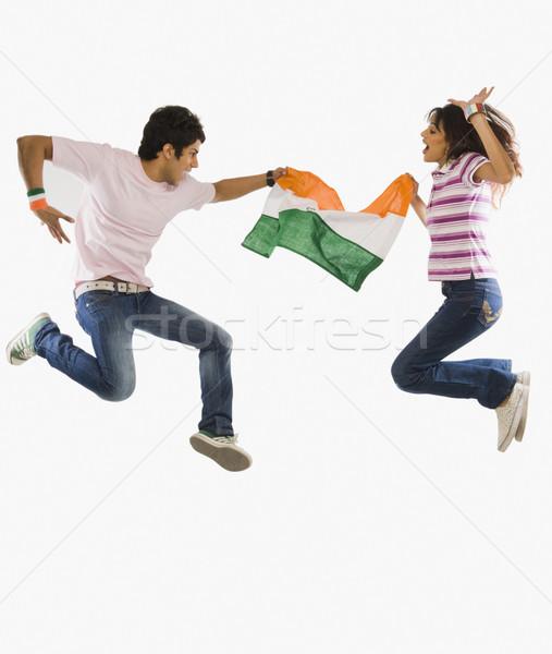 çift Hint bayrak atlama sevinç Stok fotoğraf © imagedb