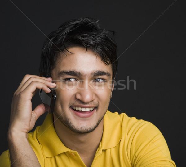 Közelkép férfi beszél mobiltelefon kapcsolat egy Stock fotó © imagedb