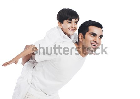 Stock photo: Happy boy riding piggyback on his father