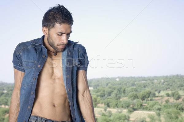 Maço adam ayakta balkon ağaç Stok fotoğraf © imagedb