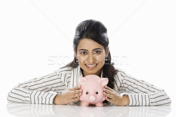 Portré üzletasszony tart persely mosolyog férfi Stock fotó © imagedb