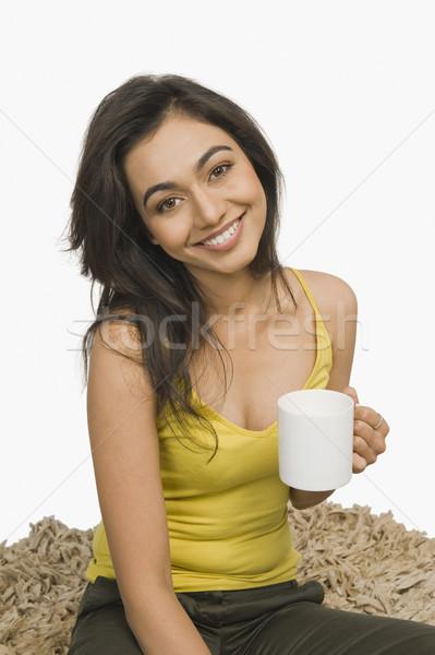 Mujer sesión taza café Foto stock © imagedb
