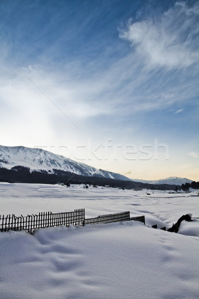 Snow covered landscape with mountain range in the background, Ka Stock photo © imagedb