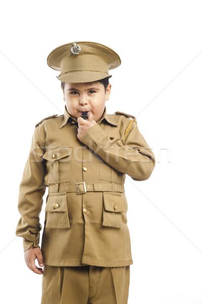 Menino polícia uniforme assobiar Foto stock © imagedb