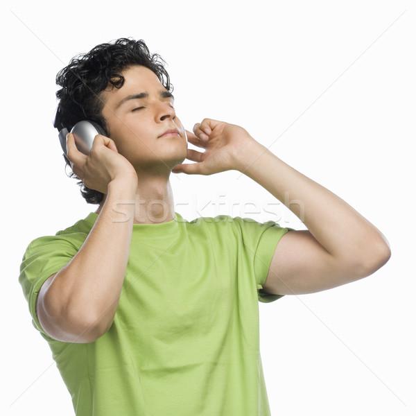 Férfi zenét hallgat zene technológia zöld fejhallgató Stock fotó © imagedb