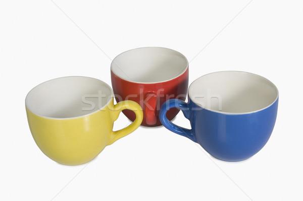 Közelkép színes teáscsészék terv kék piros Stock fotó © imagedb