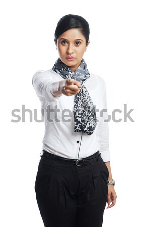 Portrait of a businesswoman pointing Stock photo © imagedb