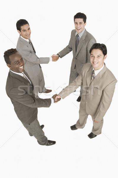4 ビジネスマン 握手 ビジネス ビジネスマン 笑みを浮かべて ストックフォト © imagedb