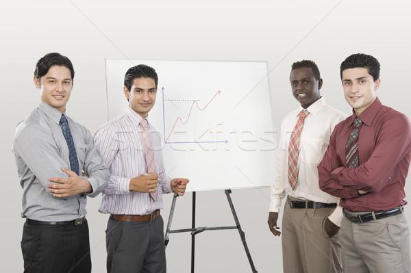 üzletemberek dolgozik kommunikáció bemutató nyakkendő mosolyog Stock fotó © imagedb